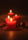Spa composition. scented candles, coffee beans, aromatic wooden balls Stock Image