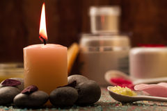 Spa composition with sea salt, candles, soap, shells, creams for face on wooden background. Aromatherapy Stock Photos