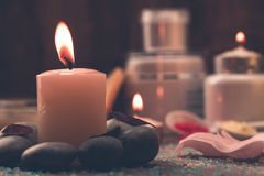 Spa composition with sea salt, candles, soap, shells, creams for face on wooden background. Royalty Free Stock Photos
