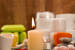 Spa composition with sea salt, candles, soap, shells, creams for face Stock Photography