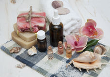 Spa composition. Sea salt, essential aroma oil,handmade soap on wooden background Royalty Free Stock Images
