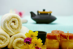 Spa composition - teapot, towels and candles Stock Photos