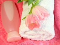 spa composition of towel, bottle and tulips Royalty Free Stock Photography