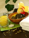 Spa composition of towel, stones and candle Royalty Free Stock Image