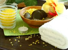 Spa composition of towel, stones and candle Stock Image