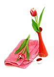 spa composition of towel and tulips Royalty Free Stock Photos
