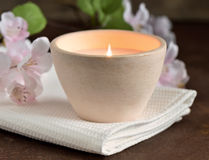 Spa composition. With white towel and burning candle stock images