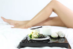 Spa composition with women leg in background Royalty Free Stock Photography