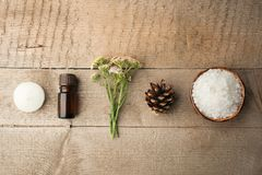 Spa composition on wooden table. Natural aroma oil, sea salt on rustic wooden background. Healthy skin care. SPA concept. Top view royalty free stock photos