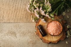 Spa composition on wooden table. Natural aroma oil, sea salt on rustic wooden background. Healthy skin care. SPA concept. Top view royalty free stock images