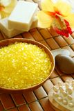 Spa composition of yellow bath salt in wooden bowl Royalty Free Stock Photography