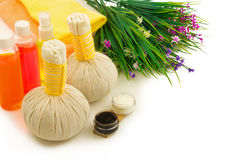 Spa compress balls, bottles of color aroma oil, decorative flowe Royalty Free Stock Image