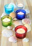 Spa concept. Tea candles and sea shells as a spa concept Stock Photos