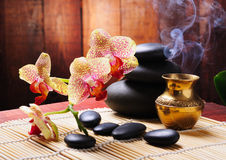 Spa concept. With orchid and zen stones Royalty Free Stock Photography