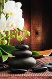 Spa concept. Zen stones and  orchid Royalty Free Stock Image