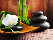 Spa concept. Zen stones and orchid royalty free stock photo