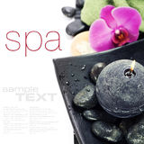 Spa concept. (zen stones, candle, towel and orchid) over white with sample text stock images