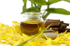 Spa concept. Essential oil and yellow flower peals Stock Image
