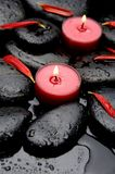 Spa concept. Spa Stones and red petals with red candle Stock Photos