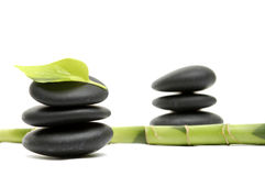Spa concept. Zen stones and bamboo with leaf Royalty Free Stock Photo