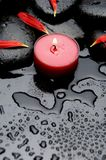 Spa concept. Spa Stones and red petals with red candle Royalty Free Stock Photos