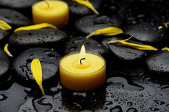 Spa concept-. Spa Stones and yellow petals with yellow candle Stock Photography