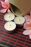 Spa Concept. Frangipani Flower and Aroma Candle on bamboo mats Royalty Free Stock Photo