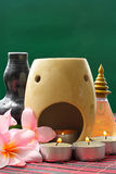 Spa Concept. Frangipani Flower and Aroma Candle on bamboo mats Stock Photography
