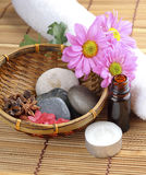Spa Concept. Bottle of essential oil, massage stones,candles,flower and bath-salt Stock Images