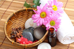 Spa Concept. Bottle of essential oil, massage stones,candles,flower and bath-salt Royalty Free Stock Photos