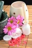 Spa Concept. Bottle of essential oil, massage stones,candles,flower and bath-salt Stock Image