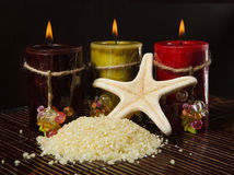 Spa concept. Mineral salts in a tranquil spa setting with candles for aromatherapy Stock Image
