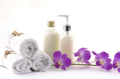 Spa concept. Towels, orchid and bath lotion on the white background Royalty Free Stock Image