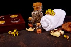 Spa concept. Aromatic candles, soap beauty and Spa cosmetic. Spa concept. Aromatic candles, towel,  soap beauty and Spa cosmetic products, salt, starfish on Royalty Free Stock Images