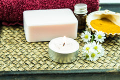 Spa concept with aromatic essence,soap and turmeric powder on tr Stock Photography