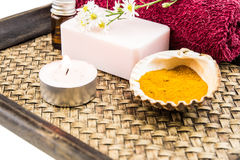Spa concept with aromatic essence,soap and turmeric powder on tr Royalty Free Stock Image
