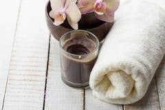 Spa concept. Bath towel, fresh flowers on white wooden backgroun Royalty Free Stock Photo