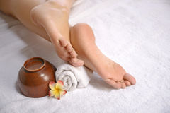 Spa Concept. Beautiful legs over white towel Royalty Free Stock Image