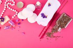 Spa concept. Beauty. Spa concept. Zen stones and aromatic lavender on pink table. Beauty and Spa cosmetic products, salt, towel. Flat lay. Copy space Royalty Free Stock Photo