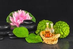 Spa concept of bergamot, leaf, fragrance oil, lotus and zen  Stock Photos