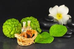 Spa concept of bergamot, leaf, fragrance oil, white plumeria and Royalty Free Stock Photos