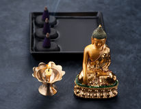 Spa concept with Buddha statues, black stones massage and incense. Spa, meditation and relaxation concept Stock Photo