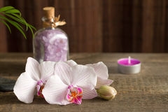 Spa concept with candle and orchid abstract still life Stock Photography