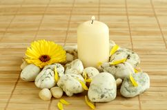 Spa concept. Candle, stones and flowers. Stock Photos