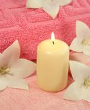 Spa concept. Candle, towel and flowers. Royalty Free Stock Photos