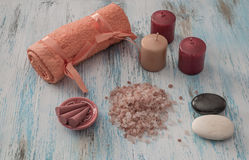 Spa concept. candles, aromatic salt, and bath orange towel Royalty Free Stock Image
