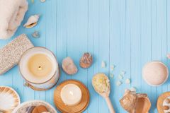 Spa concept with candles on blue wooden background. The spa concept with candles on blue wooden background Stock Photos