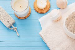 Spa concept with candles on blue wooden background. The spa concept with candles on blue wooden background Royalty Free Stock Images