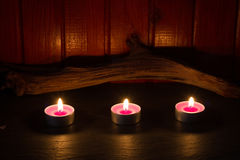 Spa concept with candles in night abstract still life background Stock Photos