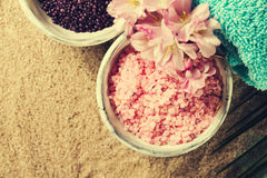 Spa Concept. Closeup of beautiful Spa Products - Spa Salt and Fl Stock Image